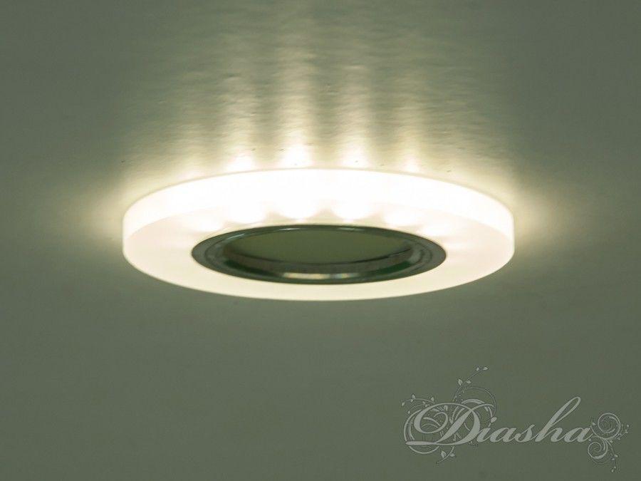 Светильник оснащен встроенным LED модулем 5W, что дает ему возможность распределения на три включения (двойной выключатель): лампа, встроенная подсветка, и одновременно и лампа и подсветка. Режим подсветки можно использовать, как самостоятельный заполняющий свет - свет равномерно рассеивается точечным светильником. Основная лампа стандарта MR-16 наоборот даёт основную часть светового потока строго вниз - этот режим хорош для подсветки стола/рабочей поверхности, чтения и тд.Светильник экономичен, красив, современен и изготовлен из акрила прнименяемого например в серии люстр 8060 и 1673, что обеспечивает ему хорошее преломление света и образование равномерного, мягкого залития по потолку. Точечные светильники просты и легки в установке, поэтому их монтирование не займет много времени и труда. Они запросто могут изменить пространство помещения. Если точечные светильники установить по периметру потолка, то он будет казаться выше, а сама комната – намного больше.Конструкция светильника идеально расчитана на использование с натяжными потолками.Примите это как руководство к действию. И тогда эти хрустальные точечные светильники будутспособны обеспечить Вам комфорт именно на том уровне, которого Вы так долго ждали! Для оптовых покупателей отпускается только ящиками по 50 шт.Лампа в комплект не входит.